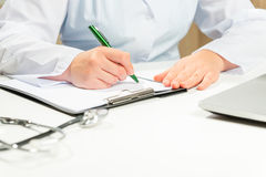 Hands close-up doctor writes diagnosis Royalty Free Stock Images
