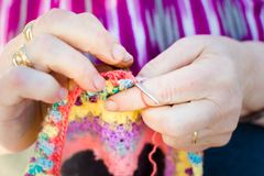 Knitting on knitting needles, using colorful wool royalty free stock photos