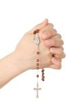 Hands closed in prayer with a rosary Royalty Free Stock Photo