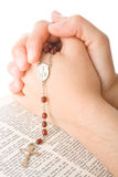 Hands closed in prayer with a rosary Royalty Free Stock Image