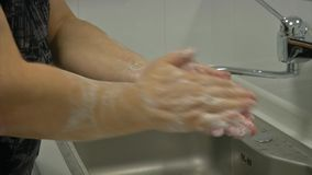 Hands closeup. Doctor is washing his hands before surgery stock footage