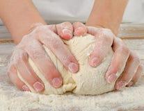 Hands closeup kneading dough Stock Photography