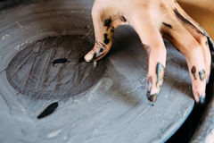 Hands closeup, working on pottery wheel with ceramics Royalty Free Stock Images