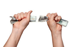 Hands clutching American money Stock Images