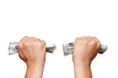 Hands clutching American money Royalty Free Stock Image