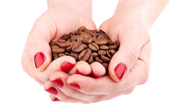 Hands with coffee beans Stock Photo