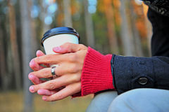 Hands with coffee cup Stock Photography