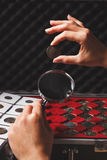 Hands with coin and magnifying glass, soft focus background Royalty Free Stock Images