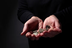 Hands with Coins Stock Image