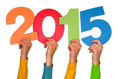 Hands with color numbers shows  year 2015 Stock Image