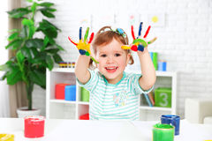 Hands in colored paint  happy child girl Stock Images