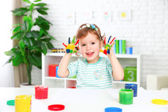 Hands in colored paint  happy child girl Royalty Free Stock Photo