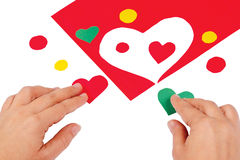 Hands combine red and green hearts Royalty Free Stock Image