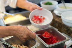 Hands in commercial kitchen Royalty Free Stock Photo