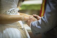 Hands of committed bride and groom Royalty Free Stock Photo