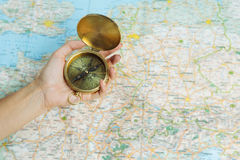 Hands with compass on the map. royalty free stock photo