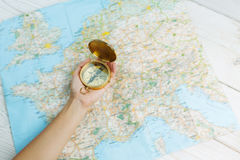 Hands with compass on the map. royalty free stock image