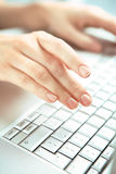 Hands and computer. royalty free stock photography