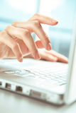 Hands and computer. Royalty Free Stock Image
