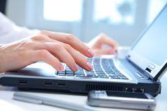 Hands on computer keyboard stock images