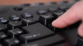 Hands on computer keyboard key to delete stock footage