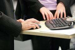 Hands on computermouse Royalty Free Stock Photography
