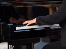 Hands of a concert pianist playing a grand piano Stock Photography