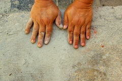 Hands on concrete floor. Asian elder woman's hands on concrete floor during housework stock photo