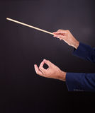 Hands of the conductor Stock Images