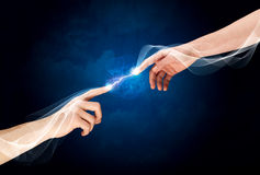 Hands connecting through fingers in space Royalty Free Stock Photos