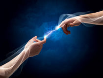 Hands connecting through fingers in space Royalty Free Stock Images