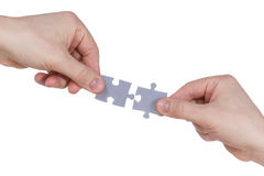 Hands connecting jigsaw puzzle Stock Photography