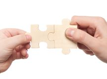 Hands connecting puzzles Stock Photos
