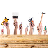 Hands with construction tools. House renovation background Stock Photo
