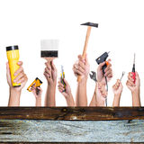 Hands with construction tools. House renovation background Stock Image