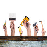 Hands with construction tools. House renovation background royalty free stock photography
