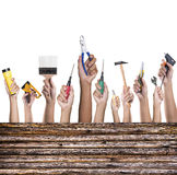 Hands with construction tools. House renovation background Royalty Free Stock Photo