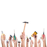 Hands with construction tools. Stock Photo