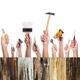Hands with construction tools. Stock Photos