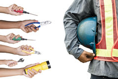 Hands with construction tools. Royalty Free Stock Images