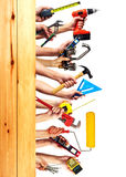 Hands with construction tools. Royalty Free Stock Image