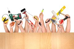 Hands with construction tools. Several hands together with different construction tools Stock Photo