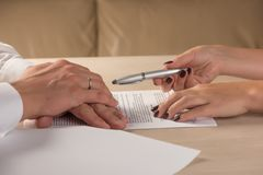 Hands of contractual parties, a woman and a man, signing a contract. Business, premarital, loan, mortgage, credit, sales and purchase, investment agreement Royalty Free Stock Photo