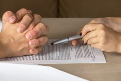 Hands of contractual parties, a woman and a man, signing a contract. Business, premarital, loan, mortgage, credit, sales and purchase, investment agreement Royalty Free Stock Photos