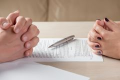 Hands of contractual parties, a woman and a man, signing a contract. Business, premarital, loan, mortgage, credit, sales and purchase, investment agreement Stock Image