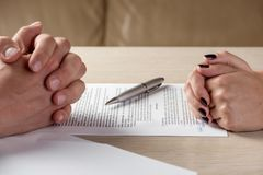 Hands of contractual parties, a woman and a man, signing a contract. Business, premarital, loan, mortgage, credit, sales and purchase, investment agreement Stock Photography