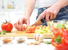Hands  cooking vegetables salad Royalty Free Stock Photos