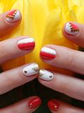 Hands with nail art. Hands with coral studded nail art royalty free stock image