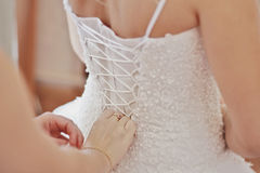 Hands and corset,mother and dauther Stock Images