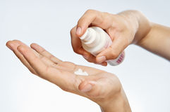 Hands, cosmetic cream, white  background, skin care Stock Photo